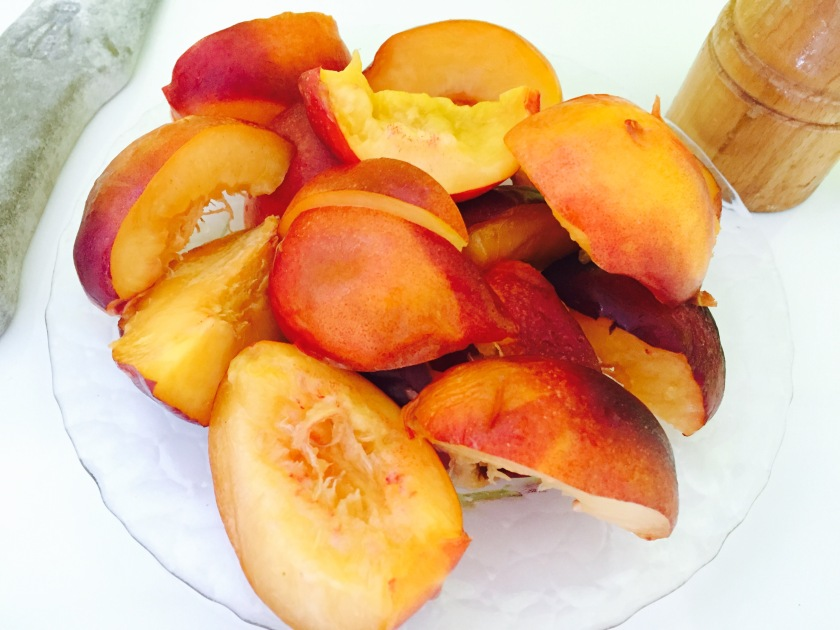 Takes those scrumptious peaches and slice them.
