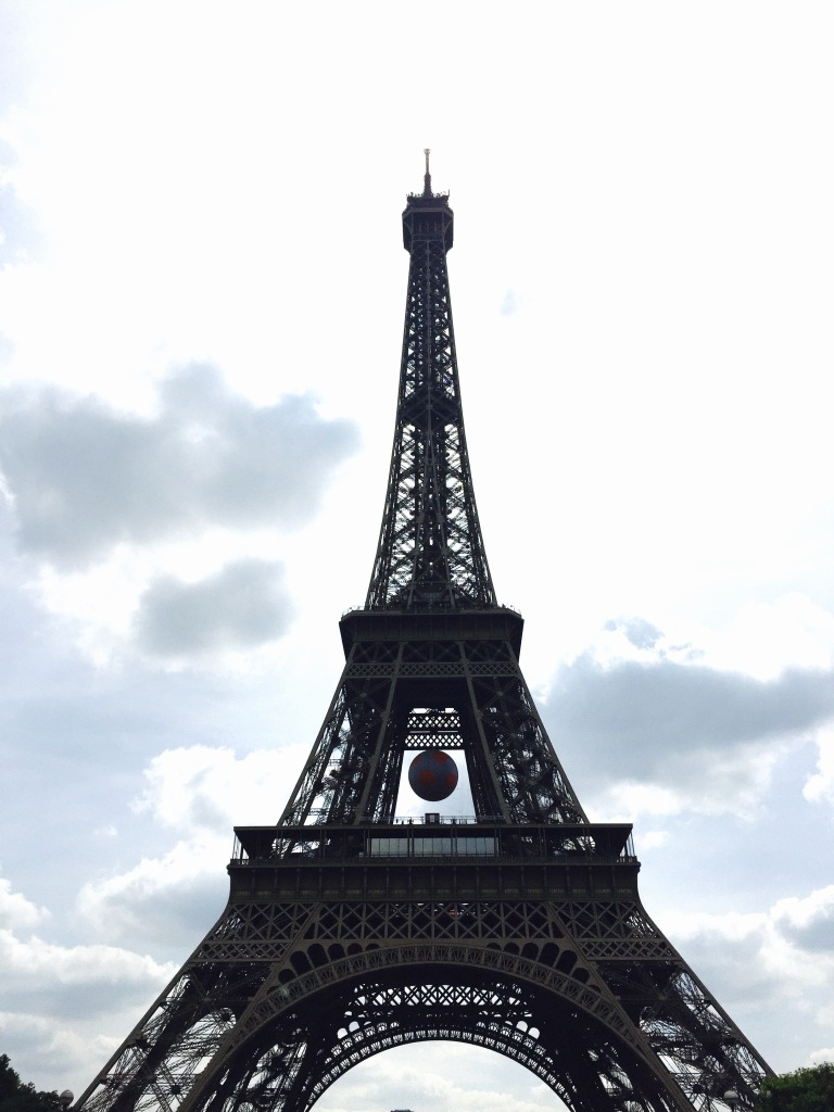 The Eiffel Tower is ready to support France in the EuroCup! It has a massive football (soccer) ball hanging between the 1 and 2 observatory floors and it is apparently a popular photo-opt for the tourists right now :)