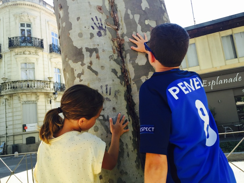After devouring some ice cream, the kids found a tree with blue painted handprints along the side. Something to pass the time :)