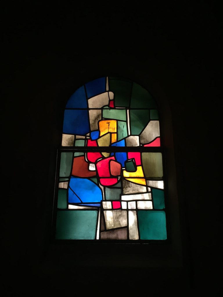 One thing you'll particularly enjoy looking at in this church are the modern stain-glassed windows. They are all unique and give opportunity for your mind to wonder on what they depict.