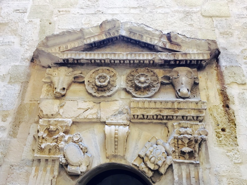 And ... As you are leisurely strolling, look around at the sculpting along the buildings. This is one of the more entertaining ones we found ... I don't know what is going on with the sheep heads here but one is in utter shock and the other looks as if his eyes were gorged out!